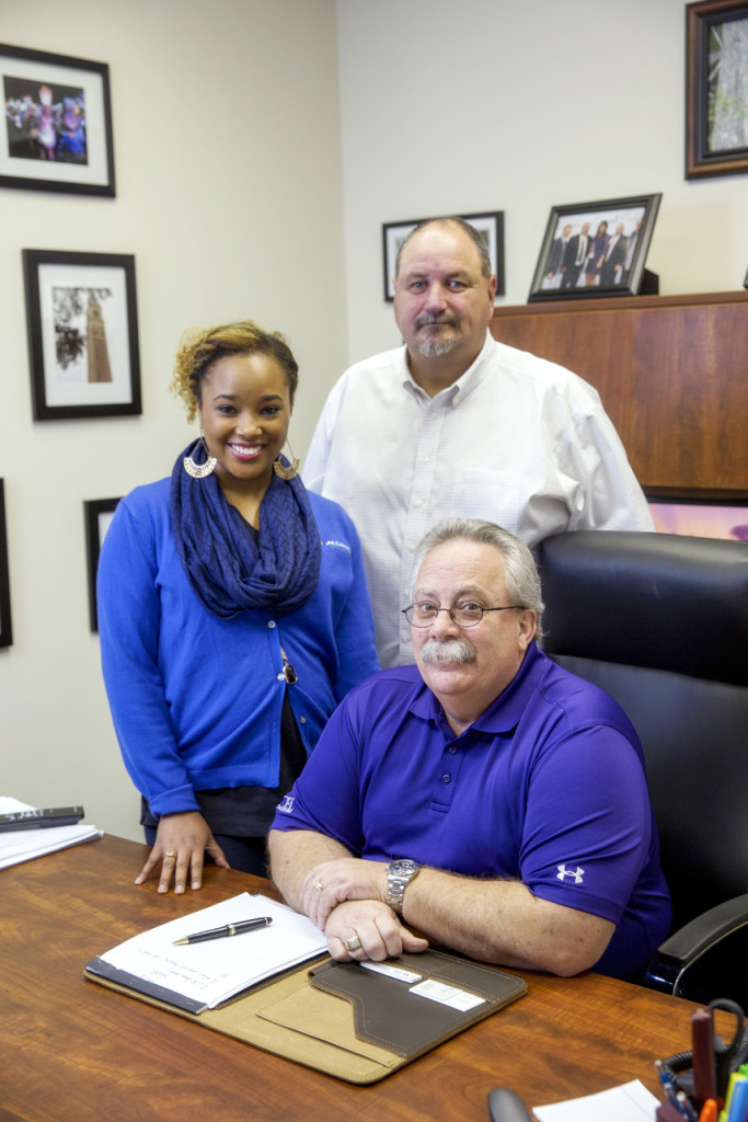 STAFF IN HOUSE: Safety Council instructor Jameelah Yazeed with EXCEL training center operators Richard Beemer, front, and Byron Ragan, back. (Photo by Collin Richie)