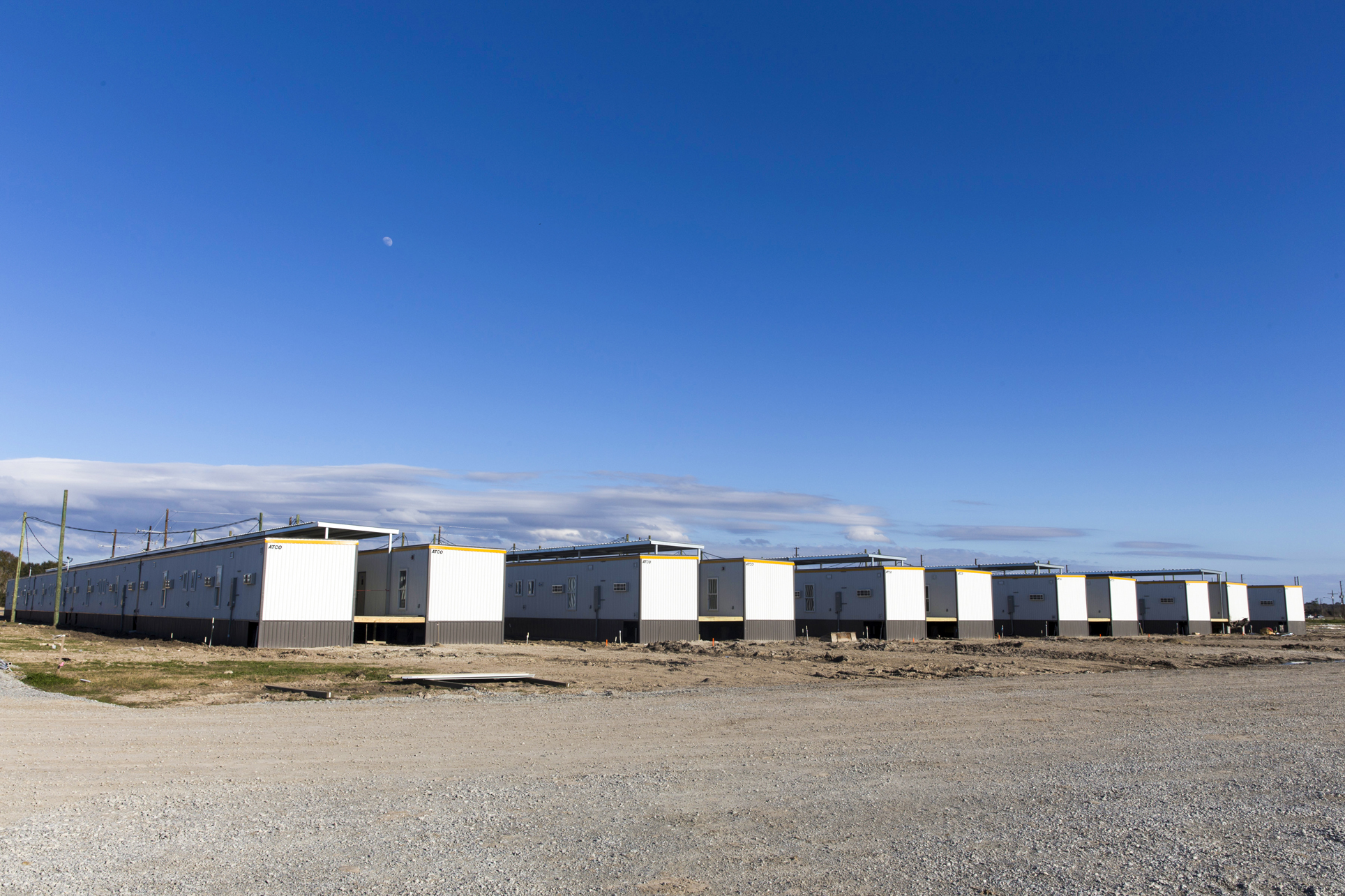 IT'S ONLY TEMPORARY: Modular housing units at the Moss Lake Village worker village, under construction near Southland Airfield in Sulphur. (Photo by Lee Celano)