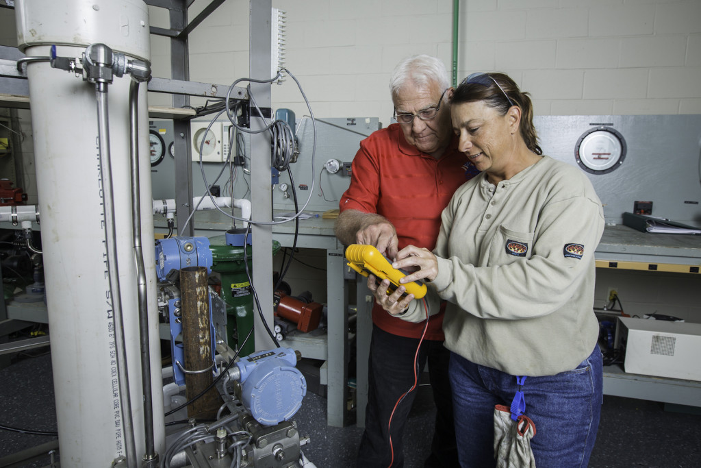 INSTRUMENT OF CHANGE: Level 4 instrument and electrical instructor Jay Lockwood works with student Jennifer Clark on a small-scale process control loop. Clark, 42, is studying instrumentation at Associated Builders and Contractors – Pelican Chapter in Baton Rouge to advance her career. (Photo by Tim Mueller)