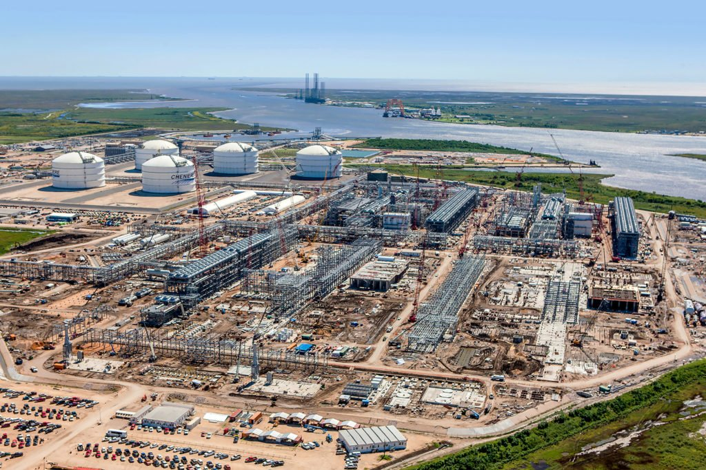 ON THE HORIZON: The price of oil is critical to the question that looms over the outlook: How many of the LNG projects will actually go vertical? Pictured: Cheniere Energy's Sabine Pass LNG plant under construction. (Photo courtesy Cheniere Energy)