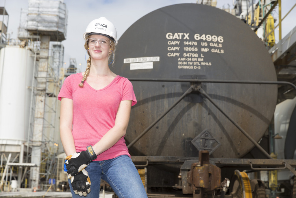 TIME OF HER LIFE: Louisiana Tech grad Lauren Cordell works among trucks and railcars at Grace in Sulphur. (Photo by Lee Celano)